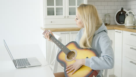 Woman-playing-electric-guitar