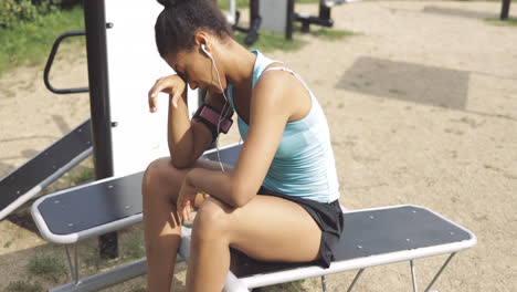 Tired-sportswoman-on-bench-in-park