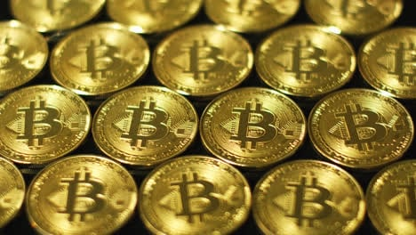 Golden-glimmering-bitcoins-in-arrangement