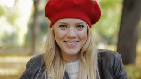 Happy-looking-woman-in-red-beret