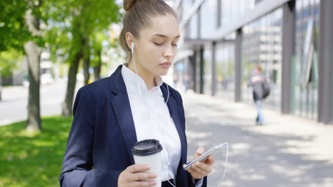 Girl-in-suit-with-coffee-and-smartphone