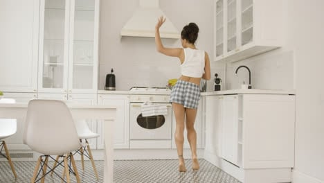 Female-dancing-in-kitchen