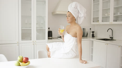Young-girl-in-towel-on-kitchen-table