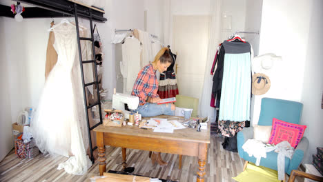 Dressmaker-with-tablet-in-parlour