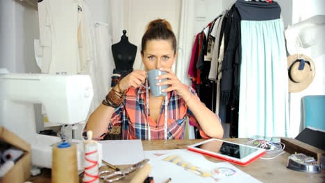 Female-tailor-drinking-coffee