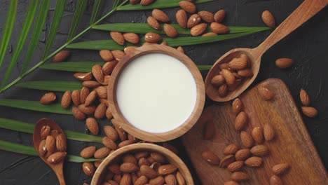 Close-up-of-Almonds-in-wooden-bowl-and-almond-milk