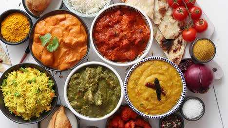 Assorted-Indian-various-food-with-spices-rice-and-fresh-vegetables