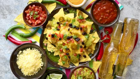Mexican-nachos-tortilla-chips-with-black-bean-jalapeno-guacamole