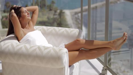 Girl-sunbathing-on-hotel-balcony