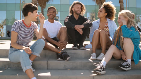 Cool-young-diverse-friends-chilling-on-street