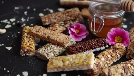 Healthy-superfood-composition-Various-kinds-granola-energy-protein-bars-with-honey-in-jar