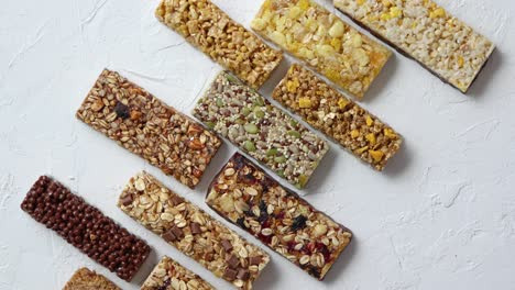 Row-of-mixed-gluten-free-granola-cereal-energy-bars-With-dried-fruits-and-nuts-
