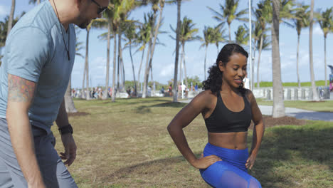 Girl-training-with-personal-trainer-in-park