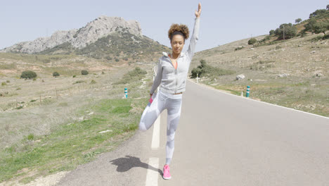 Young-woman-stretching-among-mountains
