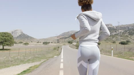 Back-view-of-running-woman