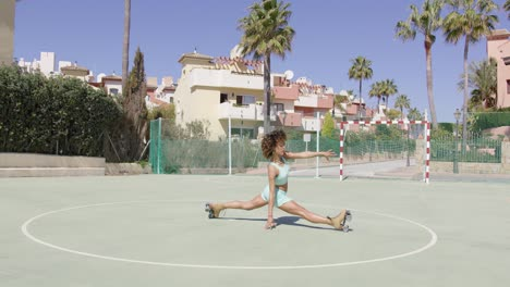 Fit-woman-in-roller-skates-stretching