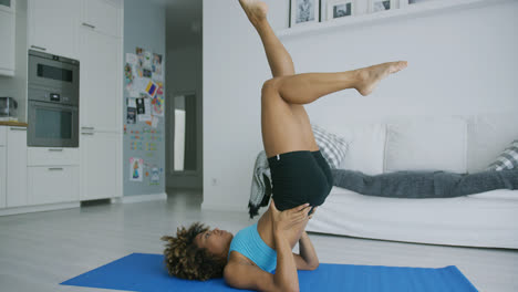 Woman-balancing-on-mat-training-yoga