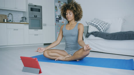 Content-woman-meditating-at-home