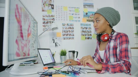 Stylish-young-woman-working-in-office