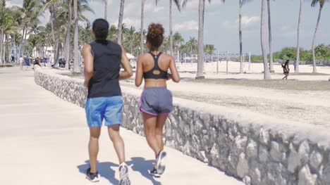 Couple-jogging-in-the-park