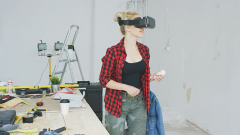 Female-in-virtual-reality-headset-in-workshop-