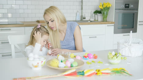 Mother-and-daughter-coloring-eggs