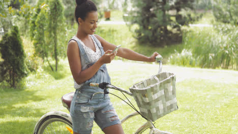 Charming-woman-with-bicycle-and-phone