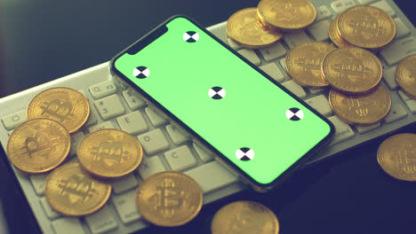 Mobile-phone-with-gold-bitcoins