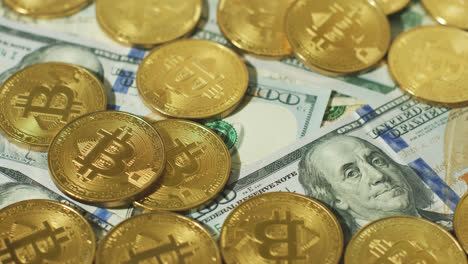 Heap-of-gold-bitcoins-on-bills