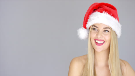 Young-sexy-woman-in-Santa-Claus-Christmas-hat