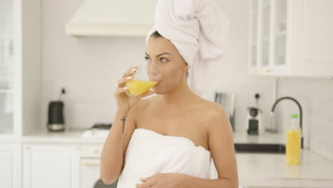 Beautiful-woman-after-bath-drinking-juice
