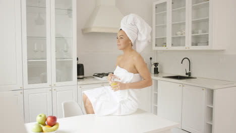 Female-wrapped-in-towel-sitting-on-table-