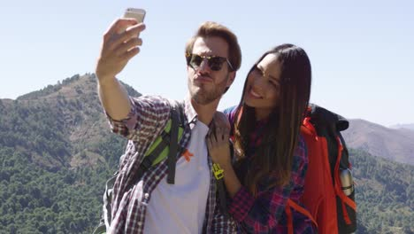 Young-couple-making-selfie-while-hiking