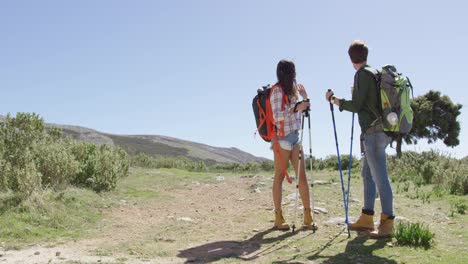 Young-couple-trekking-in-mountains