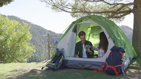 Two-people-having-rest-in-tent