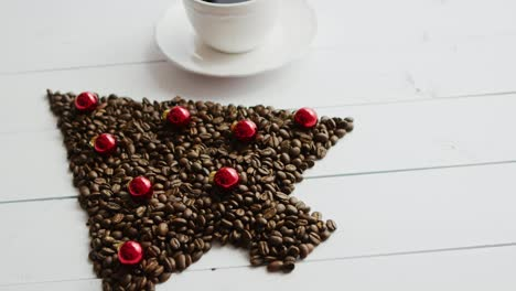 Coffee-beans-in-shape-of-conifer-and-cup