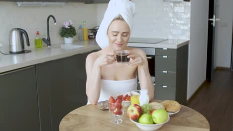 Beautiful-woman-with-towel-on-head-having-a-healthy-breakfast-and-coffee