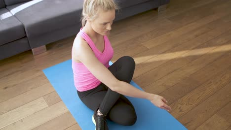 Young-beautiful-woman-stretching-at-home-in-the-morning