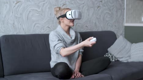 Young-woman-watching-videos-or-playing-with-VR-glasses-on-head