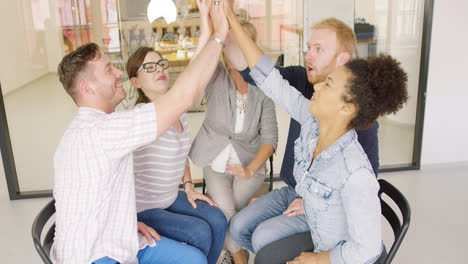 Colleagues-high-fiving-after-discussion