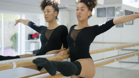 Attractive-dedicated-young-dancer-practicing