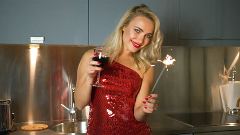 Woman-posing-with-sparkler-an-wine