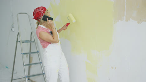Painting-wall-woman-talking-on-smartphone-