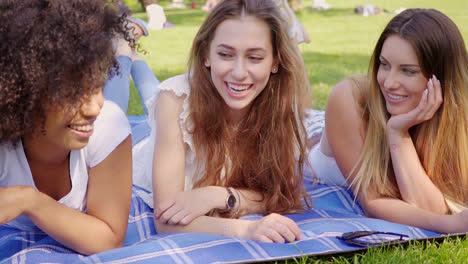 Cheerful-young-girls-lying-on-lawn