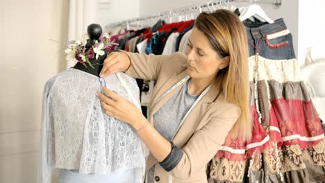 Dressmaker-working-with-mannequin