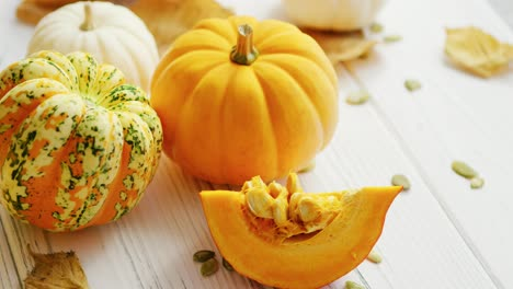Yellow-pumpkins-and-dried-leaves