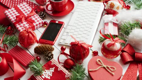 Christmas-symbols-around-devices-and-hot-beverage