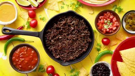 Various-fresh-and-tasty-ingredients-for-chilli-con-carne-With-meat-on-iron-pan
