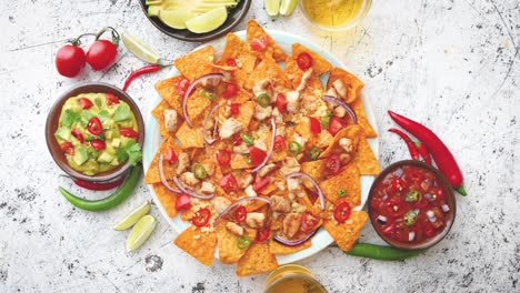 A-plate-of-delicious-tortilla-nachos-with-melted-cheese-sauce-grilled-chicken