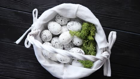 Quail-eggs-in-a-nest-on-a-black-rustic-wooden-background-Easter-symbols